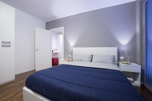 A bed or beds in a room at Dreams Hotel Residenza Pianell 10