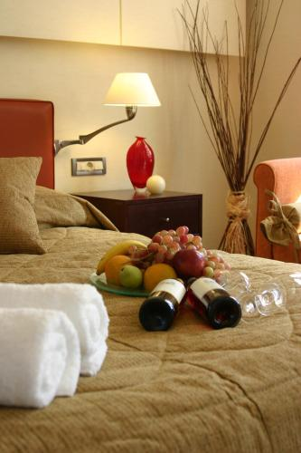 A bed or beds in a room at Alexandros Boutique Hotel