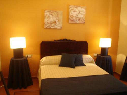 Cama o camas de una habitación en Apartamentos De Turismo Rural Heredero