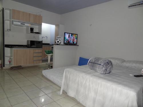 A seating area at Cumaru Flat Manaus 916