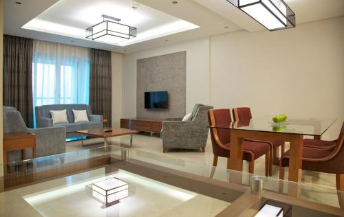 A seating area at Millennium Executive Apartments Muscat