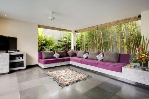 A seating area at Elok Villas