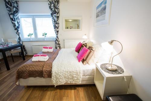 Letto o letti in una camera di Bled Apartments