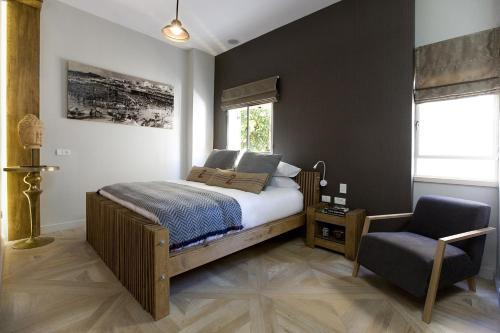Un ou plusieurs lits dans un hébergement de l'établissement Molcho Neve Tzedek Apartments by Master