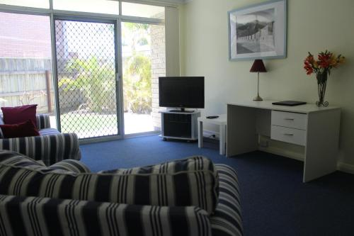 A television and/or entertainment center at Como Apartments - Geraldton