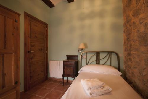 Cama o camas de una habitación en Apartamentos Doña Candida