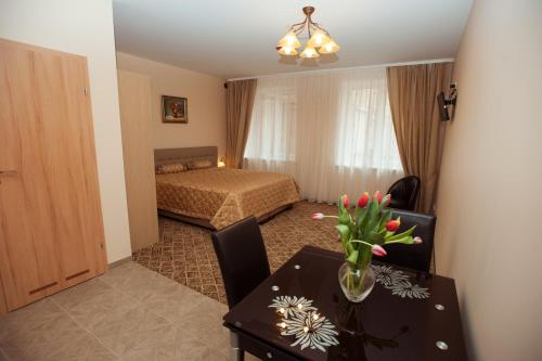 מיטה או מיטות בחדר ב-Apartamentai Vyta