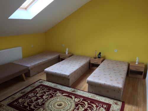 Postel nebo postele na pokoji v ubytování Apartman u Puškina