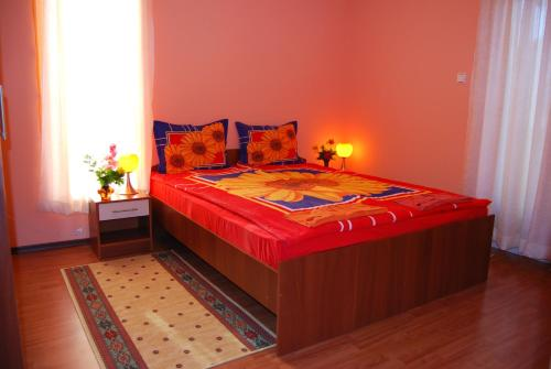 A bed or beds in a room at Fantasy Apartments