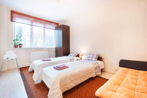 A bed or beds in a room at Rotalia Apartments