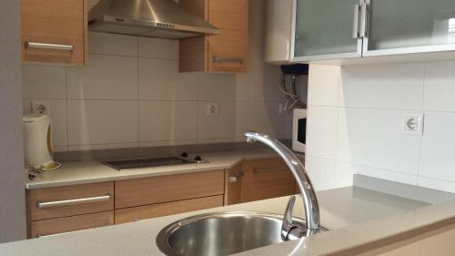 A kitchen or kitchenette at AApartments in city center