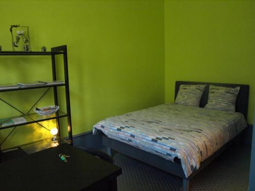 A bed or beds in a room at Appartement Le Gambetta