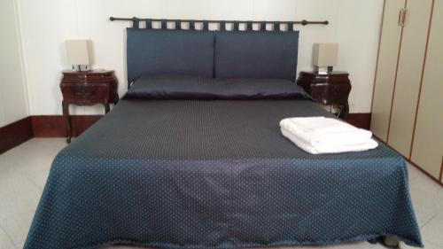 מיטה או מיטות בחדר ב-Appartamento Corte Zappa