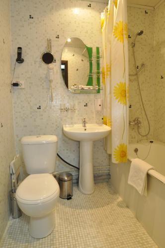 Ванная комната в Отель Александр Хаус