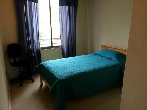 Cama o camas de una habitación en Kuizi Apartamento Santiago Centro