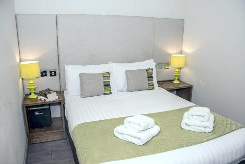 A bed or beds in a room at Base Serviced Apartments - City Road