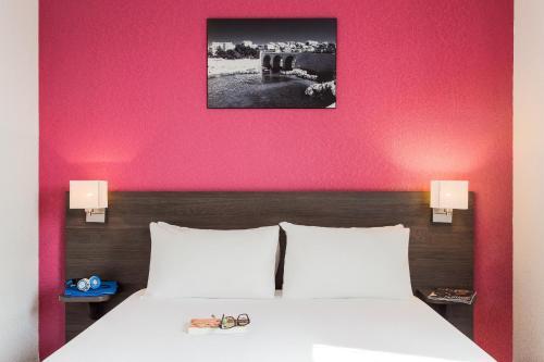 Un ou plusieurs lits dans un hébergement de l'établissement Aparthotel Adagio Access Marseille Saint Charles