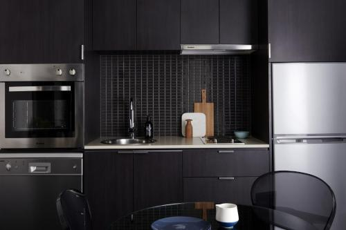 A kitchen or kitchenette at Punthill South Yarra Grand