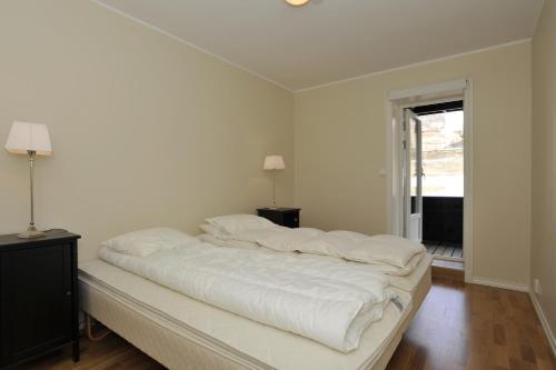 Een bed of bedden in een kamer bij Geilo Gaarden