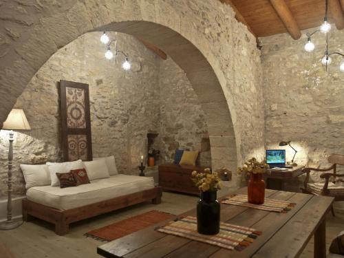 Ein Sitzbereich in der Unterkunft Critamo Cottage