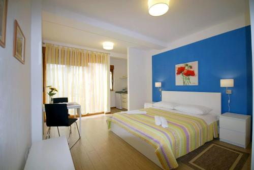 A bed or beds in a room at Apartments Sponza