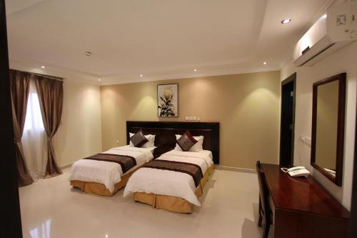 A bed or beds in a room at Taleen AlAqiq hotel apartments