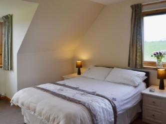 A bed or beds in a room at Ard Garraidh