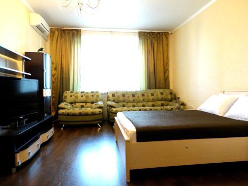 Кровать или кровати в номере InnDays Apartments on Kirova
