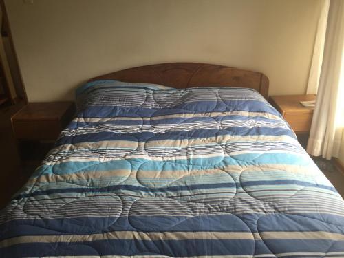 Cama o camas de una habitación en Aparthotel Residencial Gina