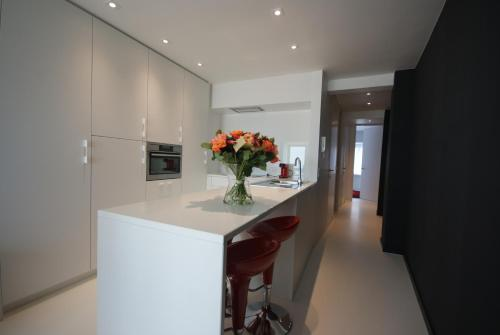 A kitchen or kitchenette at Luxe Apartment Filine