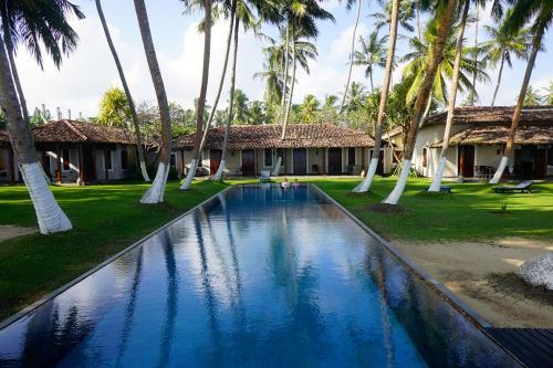 The swimming pool at or near Apa Villa Thalpe