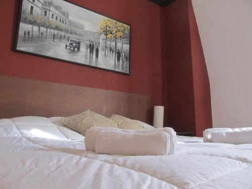 Una cama o camas en una habitación de Alojarte Mendoza