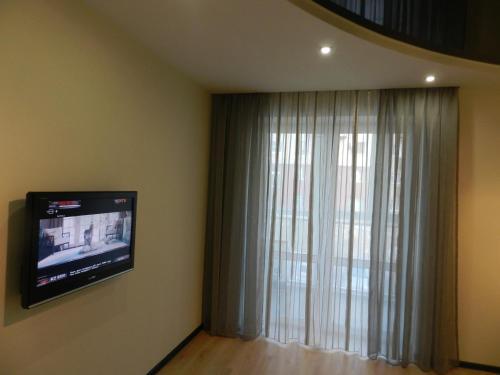 Телевизор и/или развлекательный центр в Apartment on prospekt Mira