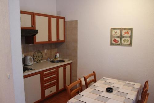 Kuchyň nebo kuchyňský kout v ubytování Apartments Marszalek