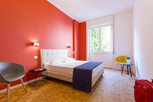 מיטה או מיטות בחדר ב-Dreams Hotel Residenza Corso Magenta