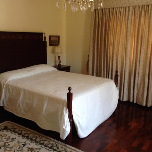A bed or beds in a room at Quinta de Santo António