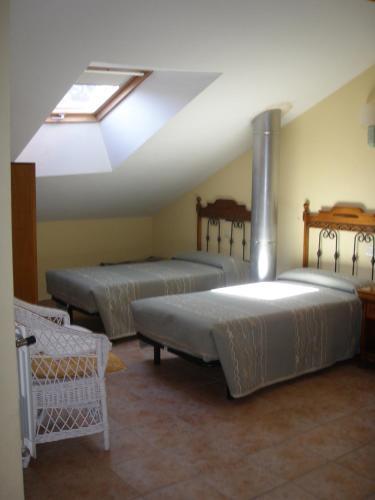 Cama o camas de una habitación en Hostal Pineda