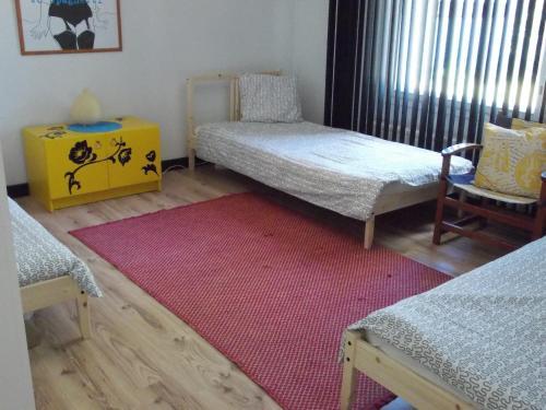 Кровать или кровати в номере Warkhaus Apartments