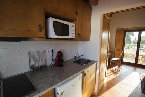 A kitchen or kitchenette at Casas Buganvilia
