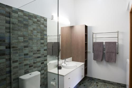 A bathroom at Altitude Apartments