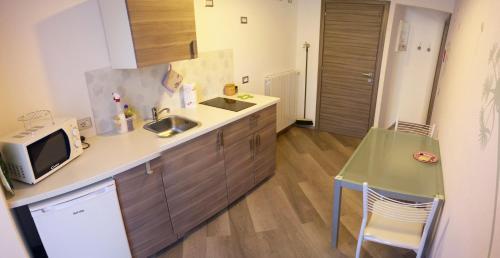 Cucina o angolo cottura di Apartment La Gatta Viola