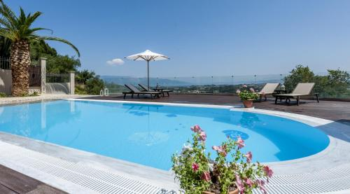 The swimming pool at or near Stephandra Villa