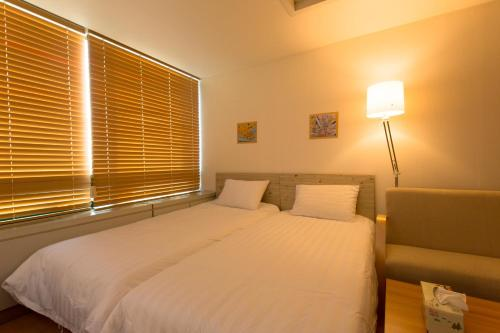 A bed or beds in a room at Jeong Stay Hongdae