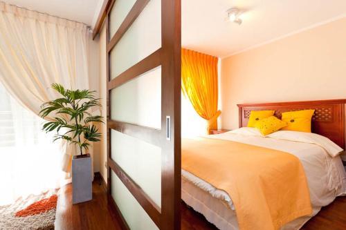 Cama o camas de una habitación en Apartments Chile Santiago 2