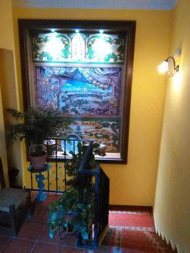 Una televisión o centro de entretenimiento en Hotel Casa Rural San Antón