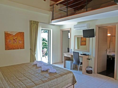 A bed or beds in a room at Eleana Boutique Hotel