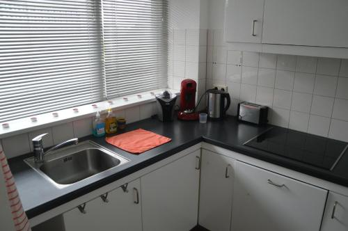 A kitchen or kitchenette at Short Stay Rotterdam City