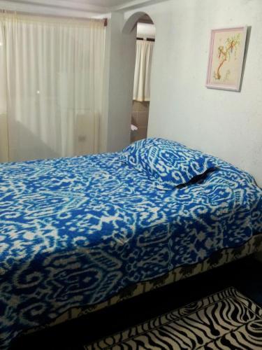 Een bed of bedden in een kamer bij Palma del Mar 2
