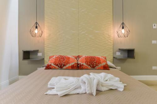 A bed or beds in a room at Eve Luxury Apartments Pantheon