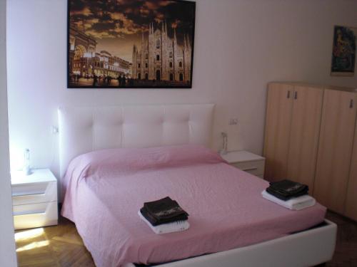 Un ou plusieurs lits dans un hébergement de l'établissement Flat in Milan 1